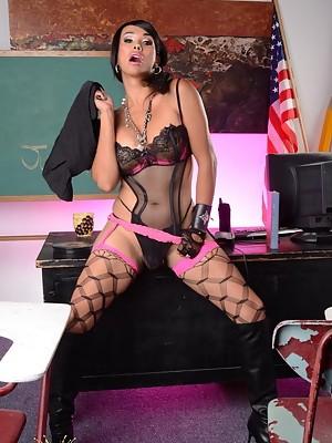 Naughty teacher Vaniity strips & poses
